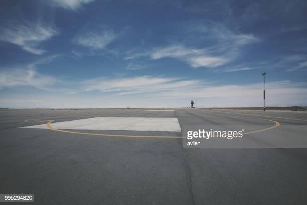 airport runway against sky - abwesenheit stock-fotos und bilder