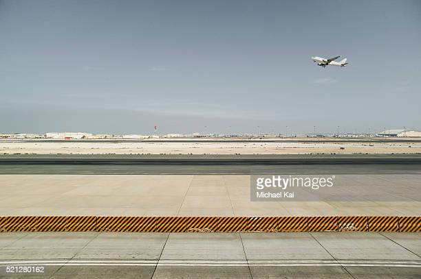 airport runway from side with departing airplane - doha stock pictures, royalty-free photos & images
