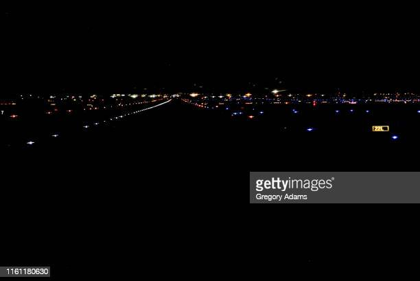 airport runway lights - airport tarmac stock pictures, royalty-free photos & images
