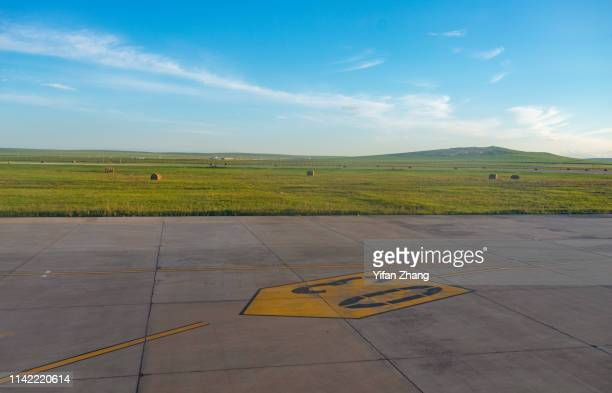 airport runway on the prairie - taxiway stock pictures, royalty-free photos & images