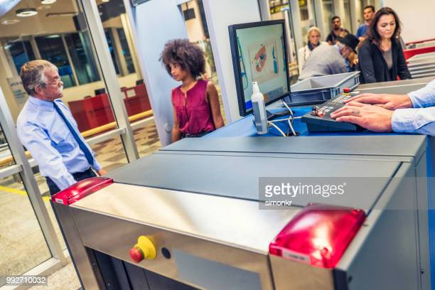 airport security check - film and television screening stock pictures, royalty-free photos & images
