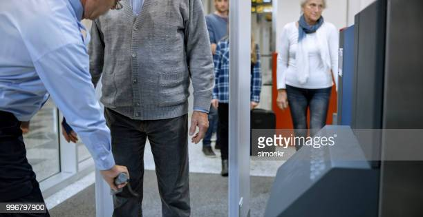airport security check - metal detector stock photos and pictures