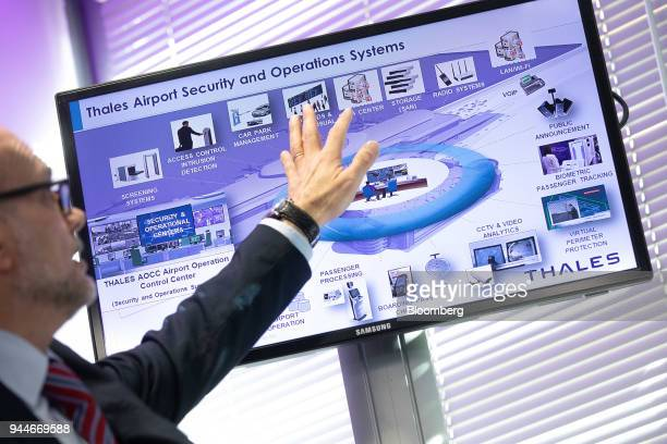 Airport security information is displayed on a screen during the Thales SA cyber security event in the Velizy district of Paris France on Wednesday...