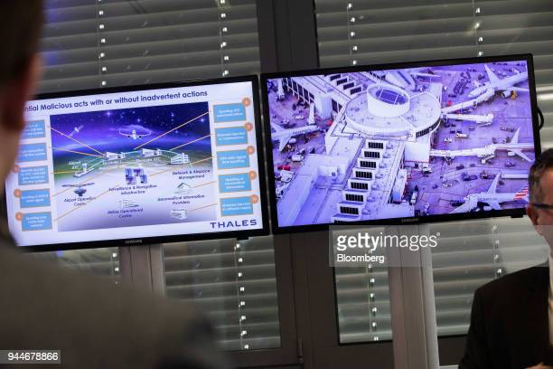 Airport security information is displayed on screens during the Thales SA cyber security event in the Velizy district of Paris France on Wednesday...