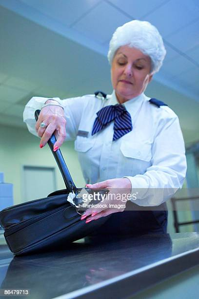 Airport security officer checking luggage