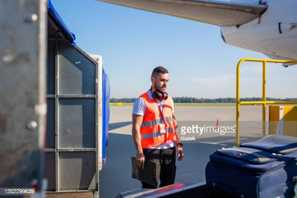 airport service crew controlling luggage - izusek stock pictures, royalty-free photos & images