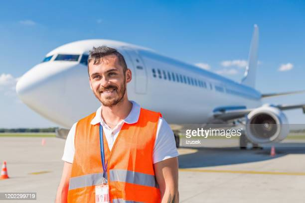 airport service crew in front of airplane - crew stock pictures, royalty-free photos & images