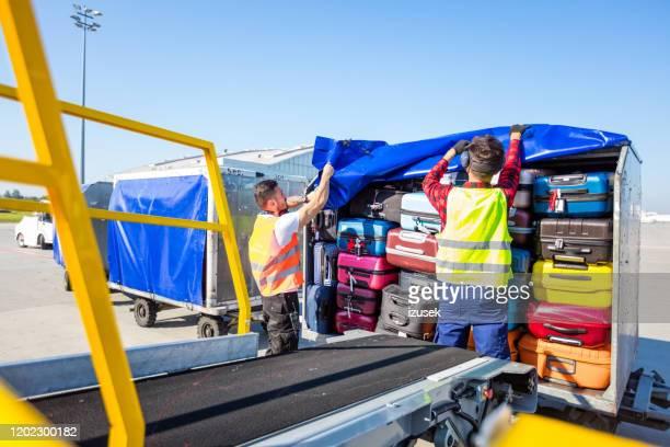 airport service crew loading luggage - crew stock pictures, royalty-free photos & images