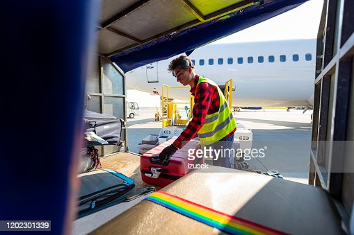 Airport Service Crew Unloading Luggage High-Res Stock Photo - Getty Images