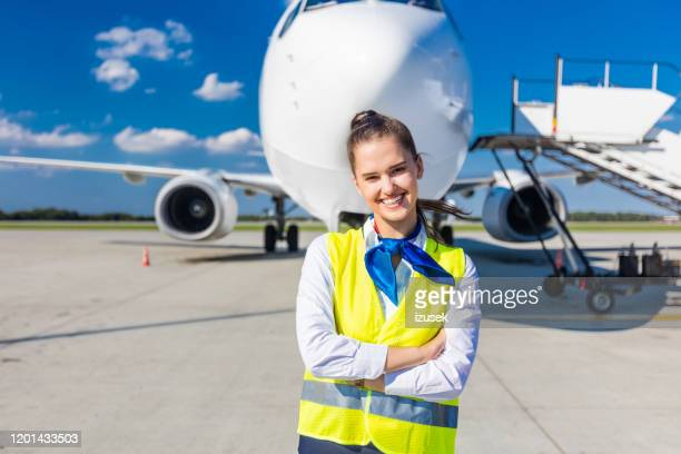 airport service young woman in front of airplane - crew stock pictures, royalty-free photos & images