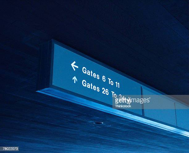 airport sign directing towards gates - thinkstock stock photos and pictures