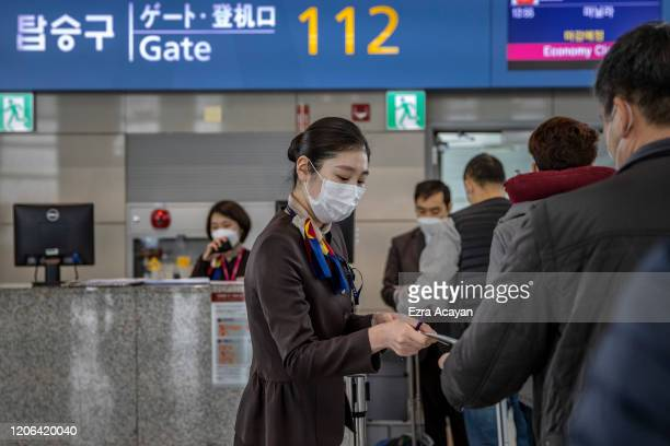 Airport staff are seen wearing facemasks to protect themselves from COVID-19 inside Incheon International Airport on March 10, 2020 in Incheon, South...