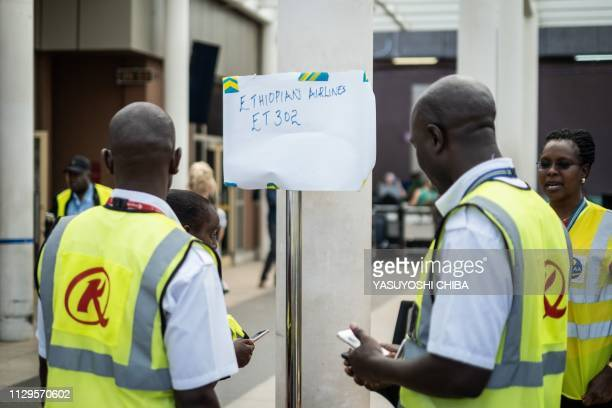 Airport staff install a help desk for the crashed Ethiopia airlines flight at the inernational arrival of the Jomo Kenyatta International Airport in...