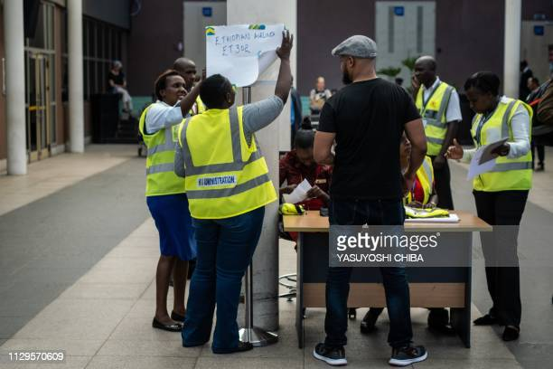 TOPSHOT Airport staff install a help desk for the crashed Ethiopia airlines flight at the international arrival of the Jomo Kenyatta International...