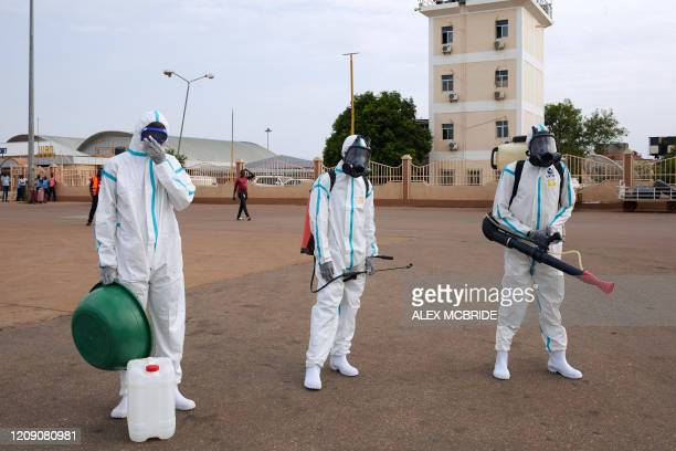 Airport staff prepare to disinfect a plane after it landed at Juba International Airport in Juba, South Sudan on April 3, 2020. - An aircraft that...