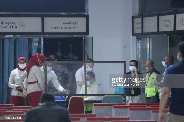 Airport staff set up a crisis centre for Sriwijaya Air flight SJY182 at the Soekarno-Hatta international airport in Tangerang near Jakarta on January...