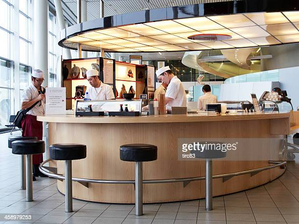 airport sushi bar - sushi restaurant stock photos and pictures