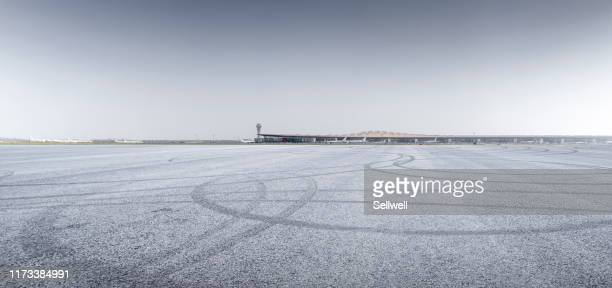airport tarmac against terminal station - airport runway stock pictures, royalty-free photos & images