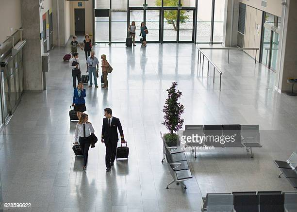 Airport terminal building and travellers