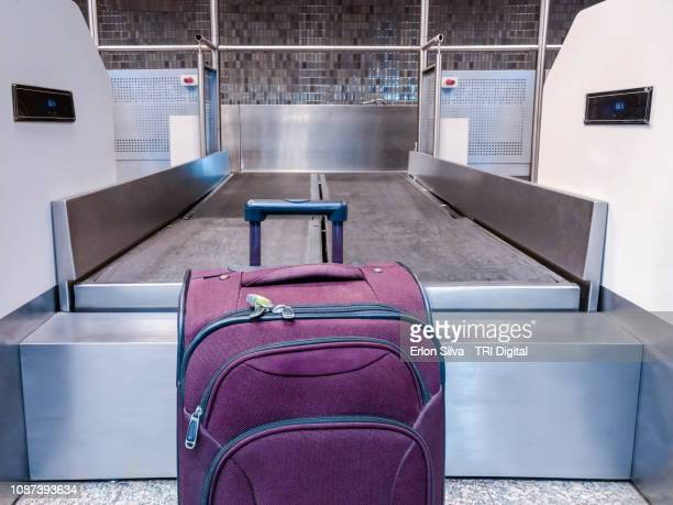 airport with a suitcase waiting for the check-in - security check - fotografias e filmes do acervo