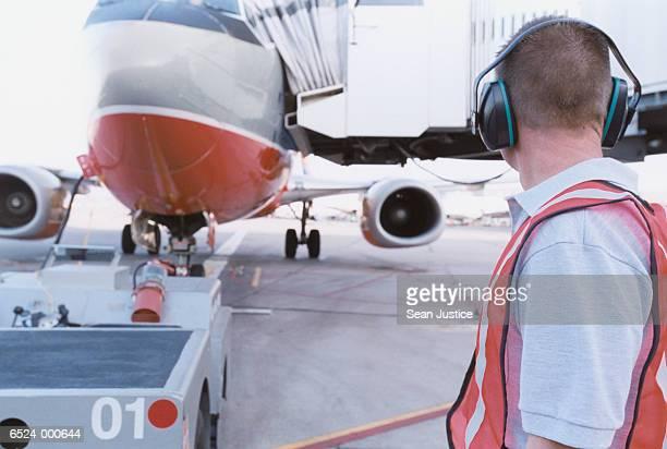 Airport Worker near Airplane