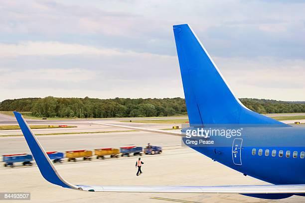 Airport Worker Servicing Passenger Jet Airplane