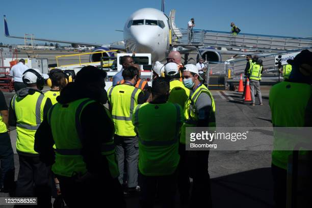 Airport workers gather ahead of the Avelo Airlines inaugural flight at Hollywood Burbank Airport in Burbank, California, U.S., on Wednesday, April...