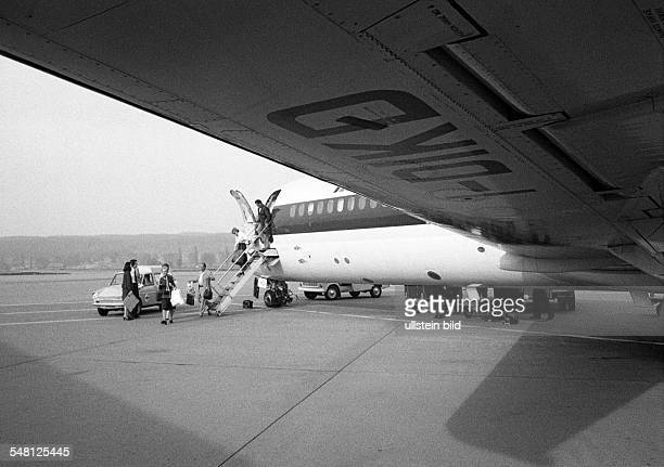 Airport Zurich, airline passengers leave the airplane and walk across the apron to the terminal building, Switzerland, Zurich -