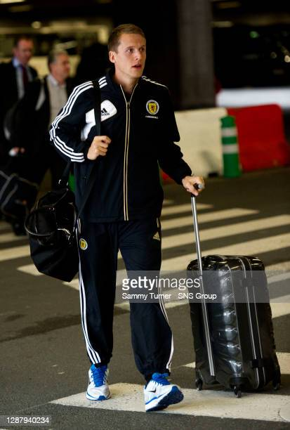 Scotland's Christophe Berra arrives in Brussels ahead of the World Cup Qualifying clash with Belgium.