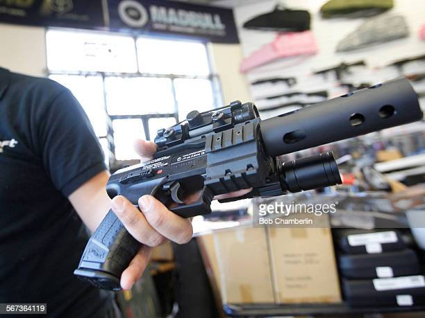 Airsoft enthuiast Jordan Baylon holds a realistic looking BB gun talks about his hobby at the Airsoft shop where he works in Glassel Park on FEBRUARY...