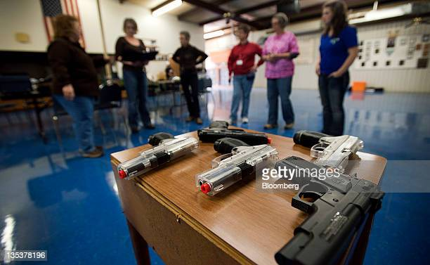 Airsoft guns sit on a table during an all women class at the Oklahoma Personal Defense Academy in Shawnee Oklahoma US on Saturday Nov 5 2011 Domestic...