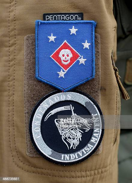 Airsoft team patches pinned to the jacket of a referee before starting a simulation of combat in a game of airsoft at Valleingrado playfield on April...