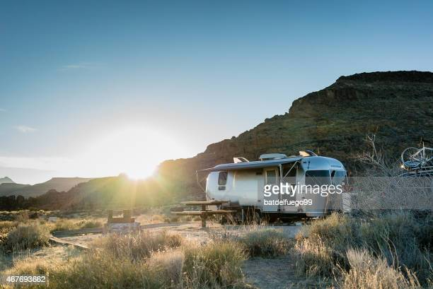 airstream trailer in mojave desert at sunset - trailer stock pictures, royalty-free photos & images
