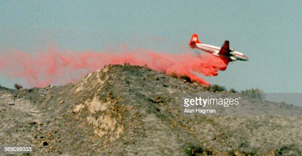 Airtanker drops fire retardant on the Bee Fire which charred over 400 acres ##please check acreage count with story%% Tuesday night and Wednesday on...