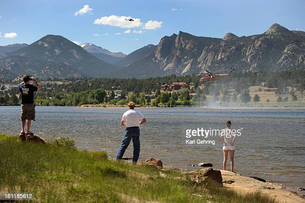 Airtanker helicopters sucked water from Lake Estes to fight a fire west of Estes Park Saturday An estimated 22 structures were consumed by fire...