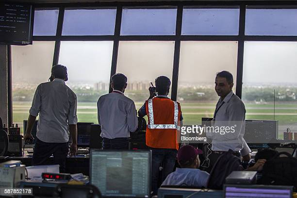 Airtraffic controllers look out from a control tower at Indira Gandhi International Airport in Delhi India on Monday July 18 2016 The world's...
