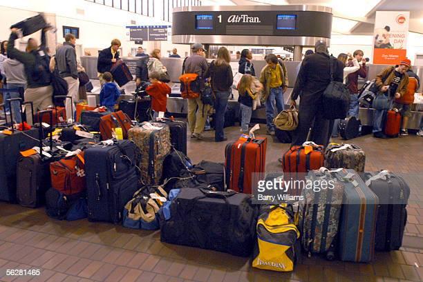 AirTran passengers wait for luggage at Atlanta's HartsfieldJackson International Airport November 27 2005 in Atlanta Georgia The Thanksgiving holiday...