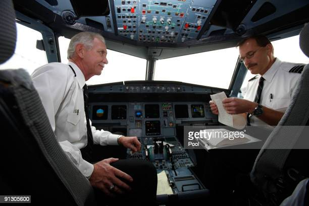 Airway pilot Captain Chesley Sully Sullenberger and copilot Jeffrey Skiles speak in the cockpit of a US Airways flight moments before takeoff from...