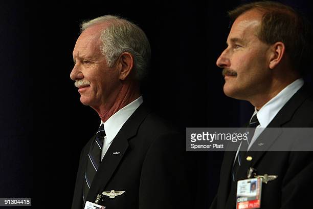 Airway pilot Chesley Sully Sullenberger and copilot Jeffrey Skiles attend a news conference at LaGuardia Airport on Sullenberger's first official day...