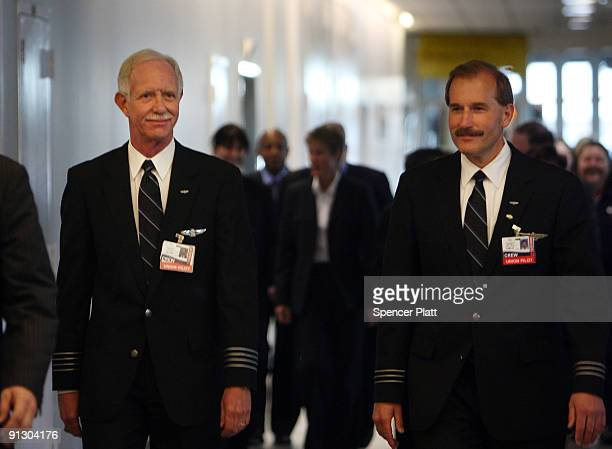 Airway pilot Chesley Sully Sullenberger and copilot Jeffrey Skiles walk to a news conference at LaGuardia Airport on Sullenberger's first official...