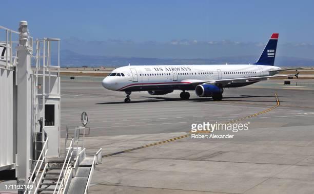 Airways Airbus A321 aircraft taxis toward its gate at San Francisco International Airport in San Francisco California