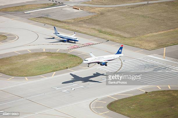 us airways airbus jet landing on runway - landing touching down stock pictures, royalty-free photos & images