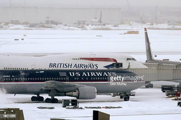 Airways and a British Airways plane sit on the tarmac at Philadelphia International Airport February 17 2003 in Philadelphia Pennsylvania All flights...