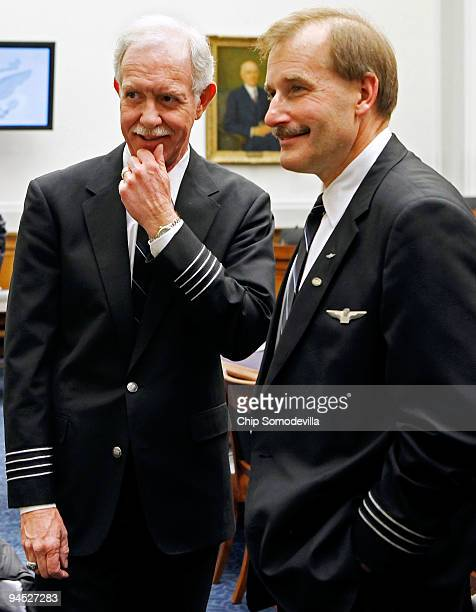 S Airways Capt Chesley Sully Sullenberger III visits with his copilot Jeffrey Skiles before to testifying to the House Judiciary Committee's...