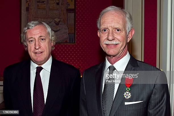 US Airways Capt Chesley 'Sully' Sullenberger poses for a photo with French Ambassador to the United States Pierre Vimont after being awarded the...