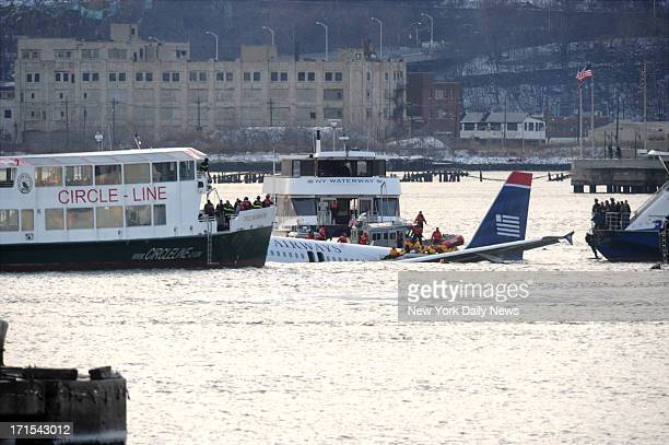 US Airways Flight 1549 crashes in Hudson River Rescue crews surround the US Airways plane where passengers can be seen being rescued on Hudson River...