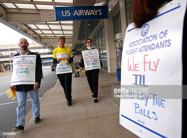 S Airways flight attendants represented by the Association of Flight Attendants AFLCIO picket to protest working conditions and worker/management...