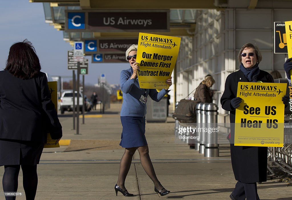 US Airways Group Inc. flight attendants picket at Reagan National Airport in Washington, D.C., U.S., on Wednesday, Nov. 14, 2012. 6,700 flight attendants, represented by the Association of Flight Attendants-CWA (AFA), are currently taking a strike vote to demonstrate what they are willing to do to achieve a contract that can be ratified. Photographer: Andrew Harrer/Bloomberg via Getty Images