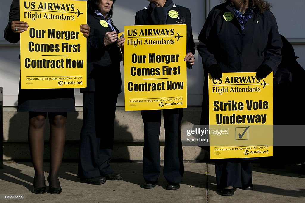 US Airways Group Inc. flight attendants wait to start picketing at Reagan National Airport in Washington, D.C., U.S., on Wednesday, Nov. 14, 2012. 6,700 flight attendants, represented by the Association of Flight Attendants-CWA (AFA), are currently taking a strike vote to demonstrate what they are willing to do to achieve a contract that can be ratified. Photographer: Andrew Harrer/Bloomberg via Getty Images
