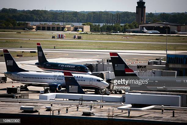 US Airways Group Inc jets sit on the tarmac at Philadelphia International Airport in Philadelphia Pennsylvania US on Wednesday Sept 8 2010 Pilots for...